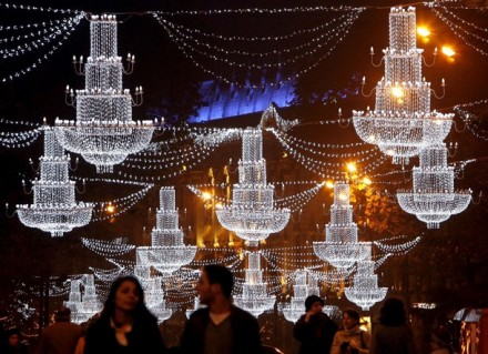 People walk on the street illuminated with Christmas decorations in Tbilisi, December 6, 2009. REUTERS/David Mdzinarishvili(GEORGIA SOCIETY RELIGION IMAGES OF THE DAY)